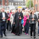 Archbishop Dermot Martin with residents and supporters at the candle-lit procession. Photo: Arthur Carron