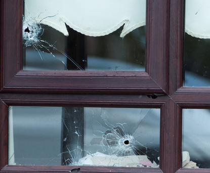 Attack: Bullet holes in a house window in Cherry Orchard