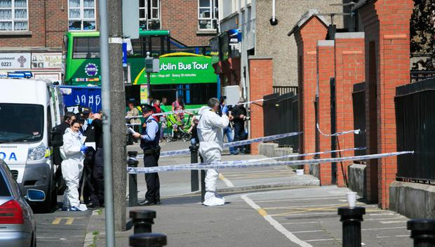 Above, gardaí at the scene of the murder of Gareth Hutch Picture: Collins Dublin