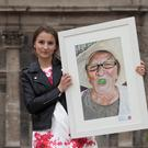 Winner Marta Turalska with her portrait 'My Grandma With Grape'. Photo: Peter Houlihan