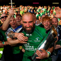 Legend: Connacht captain John Muldoon celebrates with the trophy Photo: Stephen McCarthy