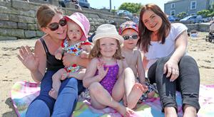 Denise Derham and her sister Orla, from Ballybrack pictured with Cara Gormley (1), Harley Wallace (4) and Ethan Gormley (3) at Sandycove. Photo: Colin Keegan, Collins Dublin