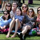 Elizabeth Powers, Roisin O'Dwyer, Niamh Lowe, Siobhan Gavagan, Emma Kinsella, Rachel Pierce and Deirdre O'Sullivan enjoy the sun in the Phoenix Park. Photo: Steve Humphreys