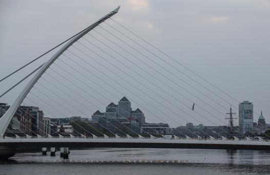 This man takes his life in his hands as he climbs the stay cables of Dublin's Samuel Beckett Bridge Photo: Conor McCabe