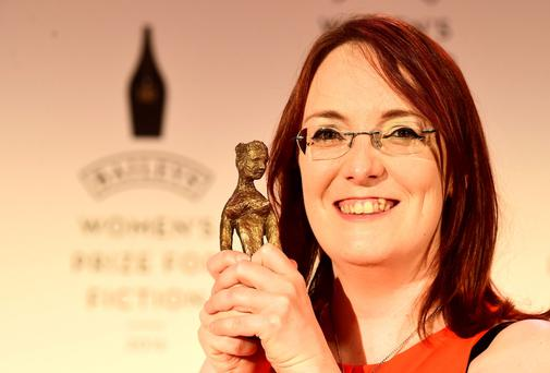 Galway author Lisa McInerney with her trophy for the Bailey's Women's Prize for Fiction Photo: PA