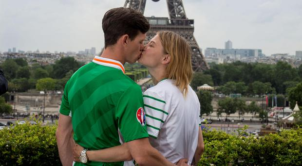 City of lights: Emmet Murphy and Ivy Tatlock from Ennis in Clare taking in the views on their way to the fanzone as Euro 2016 kicks off in Paris Photo: Mark Condren