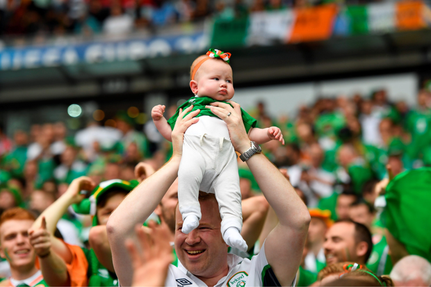 Eoin McCann, pictured above right with wife Roisin, holds up baby Aoife during the Ireland-Sweden game at the Stade de France