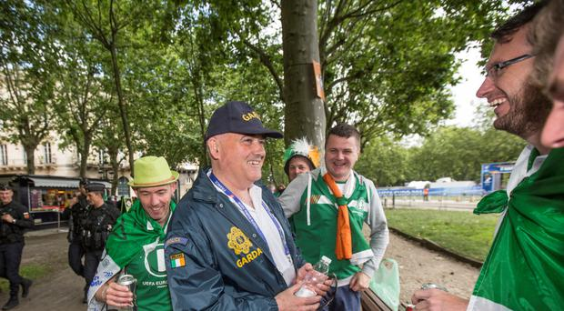 Garda Sergeant Séamus Magee mixing with Irish supporters in Bordeaux, southwest France, yesterday. Photo: Mark Condren