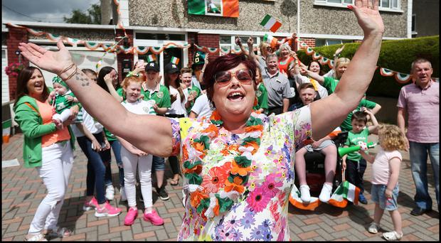 Robbie Brady's mother Maria celebrates with family members in Raheny. Photo: Steve Humphreys