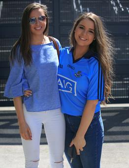 Cheering on their sides yesterday at the Leinster Senior Football Championship were Niamh Costello from Whitehall and Cliodhna Bolger from Glasnevin. Photos: Gareth Chaney