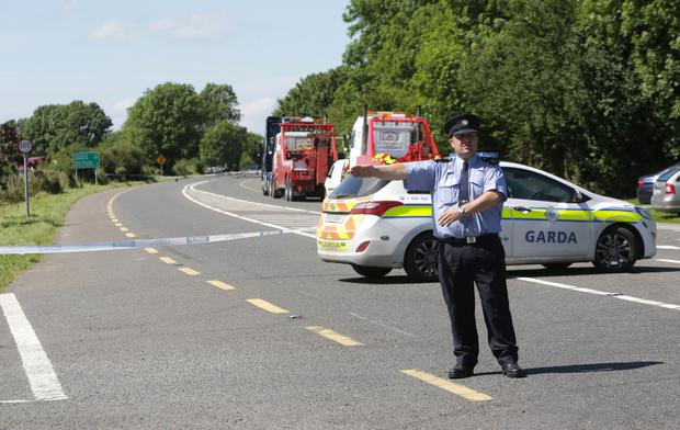 A garda directs traffic away from the N24 Photo: Damien Eagers