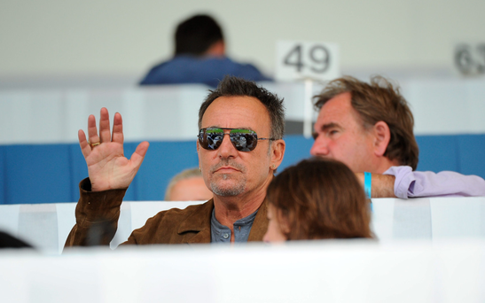 Bruce Springsteen waves from the stands. Photo: Sam Barnes