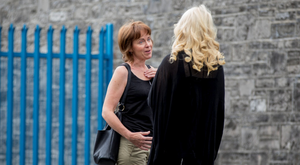 FIRST VISIT: Niamh Horan talks to John Bowe's wife, Frances, outside Mountjoy prison's training unit yesterday morning
