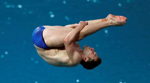 Oliver Dingley competes in the men's diving 3m springboard. Photo: Getty