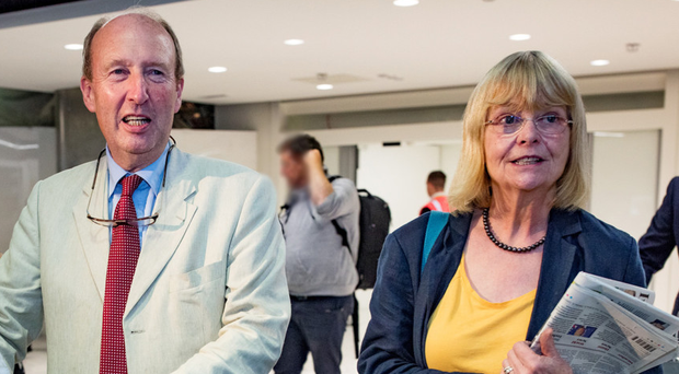 Minister for Sport Shane Ross and his wife Ruth arrive home at Dublin Airport yesterday. Photo: Arthur Carron