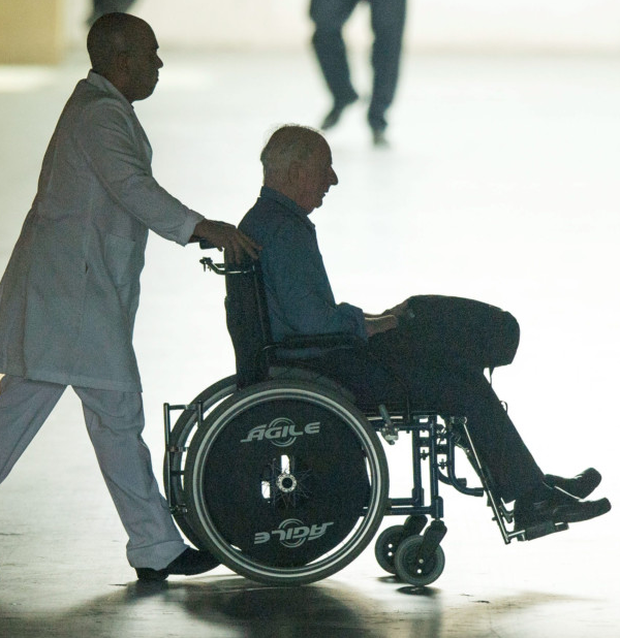 Former OCI president Pat Hickey leaves Rio's Hospital Samaritano Barra in a wheelchair Photo: Brendan Moran