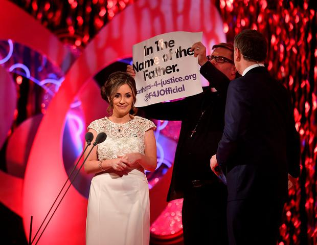 Daithi O Shea looks on as a Fathers4Justice protester storms the stage during the Rose of Tralee. Photo: Frank Mc Grath