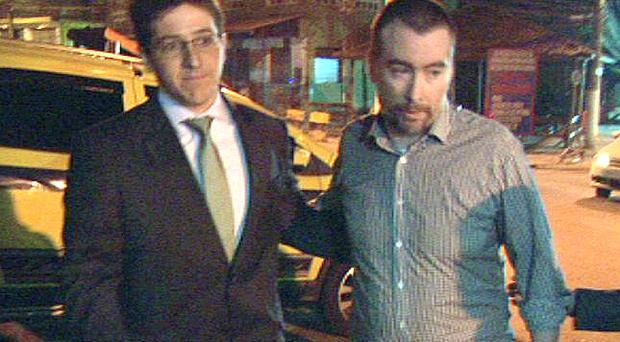 Kevin Mallon leaving Bangu prison with his lawyer. Photo: Ray Kennedy/RTÉ