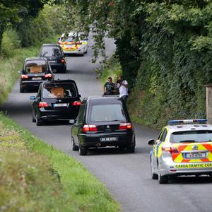 Hearses containing the remains of the victims leave the scene in Ballyjamesduff, Co Cavan. Photo: Colin Keegan