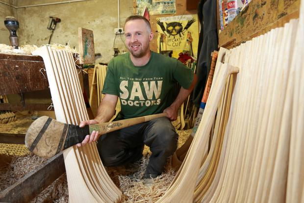 Mark Dowling with one of Henry Shefflin's old hurleys. Photo: Frank McGrath
