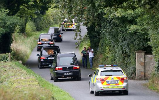 Tragedy: Four hearses containing the remains of the Hawe family leave the scene at Oakdene, Ballyjamesduff on Monday. Photo: Colin Keegan