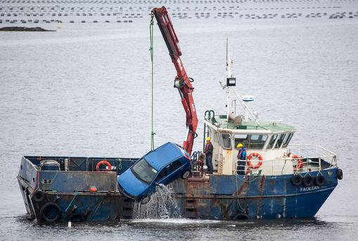 The car is recovered from the pier at Kerrykeel