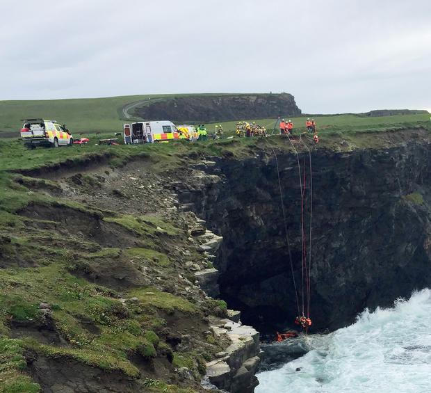 Rescuers try to reach James Lucey, who was trapped in a cave. Photo: Press 22