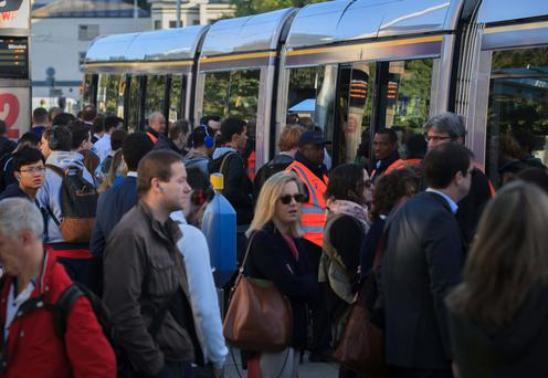Commuters crowd the Luas platform at Heuston Station due to the ongoing bus strike. Photo: Gareth Chaney/Collins