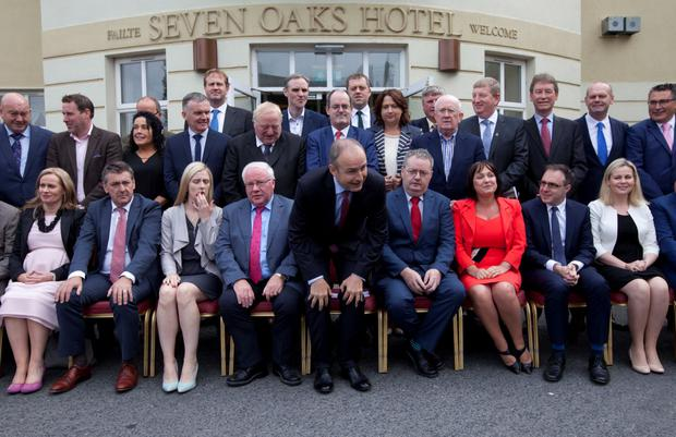 Micheál Martin takes his seat for the family portrait at the Fianna Fáil 'think-in'. Photo: RollingNews.ie