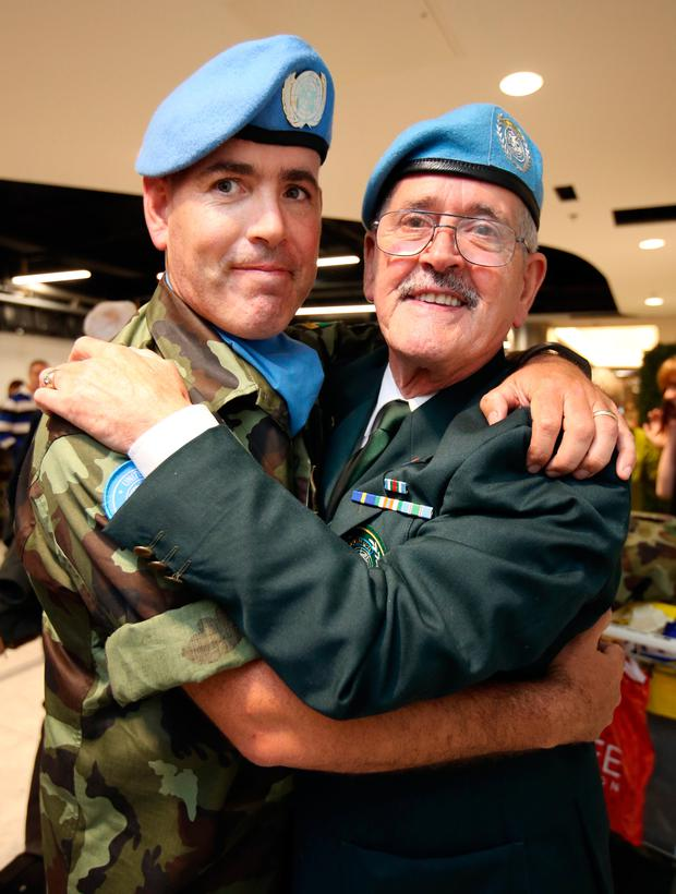 Sgt Glenn Phelan from Clonsilla,hugs his Dad Noel Phelan [ who served in the Irish Army], after the 52 Infantry Batt returned to Dublin Airport after a 6 month deployment to the Golan Heights. Picture Credit : Frank Mc Grath