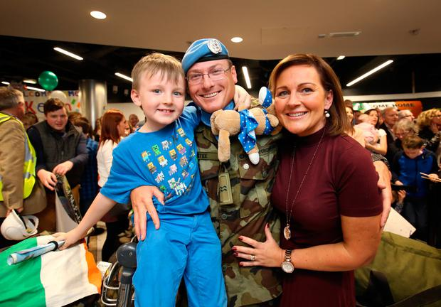 Cpl Daniel McEntee from Castleblaney pictured with his wife Roseanna and their son Benjamin [6], after the 52 Infantry Batt returned to Dublin Airport after a six month deployment to the Golan Heights. Picture Credit : Frank Mc Grath