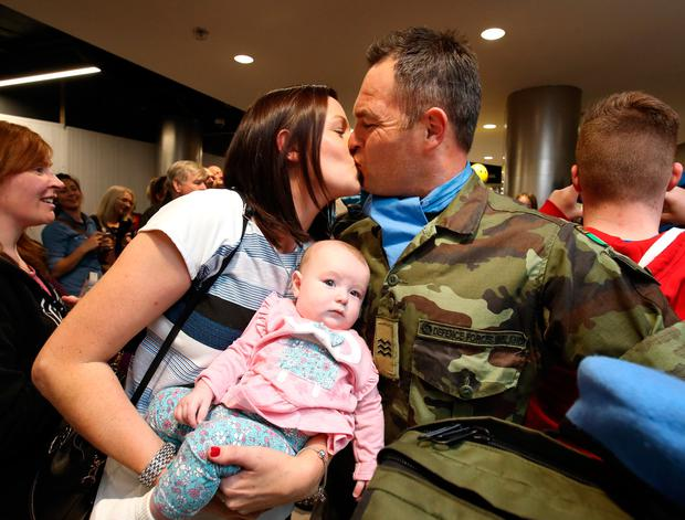 Sgt Ciaran Smithers pictured with his wife Michelle and daughter Emily [6 mths], after the 52 Infantry Batt returned to Dublin Airport after a six month deployment to the Golan Heights. Picture Credit : Frank Mc Grath