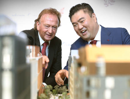 LIFFEY LIFE: Sean Mulryan, chairman of Ballymore, and Ching Chiat Kwong, Oxley Holdings, at the launch of the new docklands development