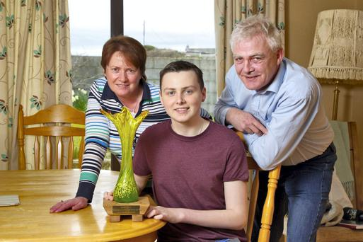 Donal Walsh pictured with his parents Finbarr and Elma Walsh.