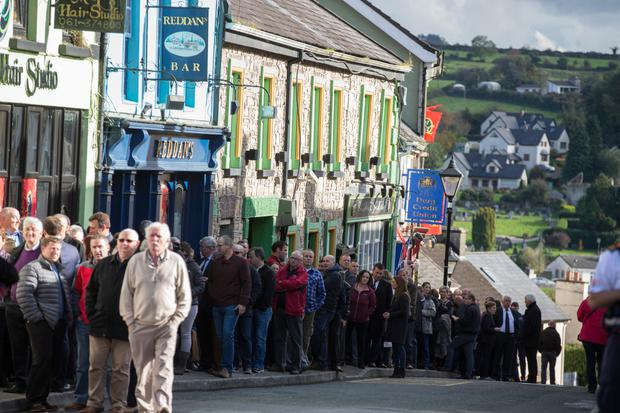 Crowds gather to pay respects at the removal of Anthony Foley at Killaloe Photo: Mark Condren