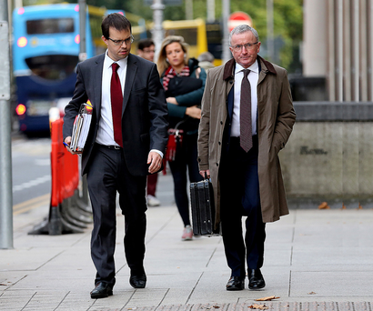 Alan Stewart, senior divisional solicitor at Nama, and Michael Moriarty, head of asset recovery, arrive at Leinster House for the PAC hearing Photo: Tom Burke