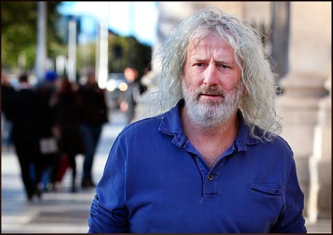 Mick Wallace TD leaving a High Court Bankruptcy Court following an application which was heard to have Mick Wallace adjudicated a bankrupt. Photo: Steve Humphreys