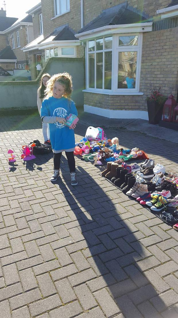 Lexi sold some of her stuff to raise money to buy sleeping bags