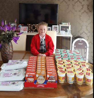 Lexi (7) with some of the food she bought for the homeless