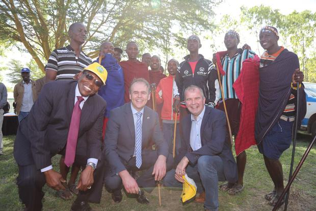 Richard Rugendo, Joe McHugh and Derek Roulston meet members of the Maasai tribe
