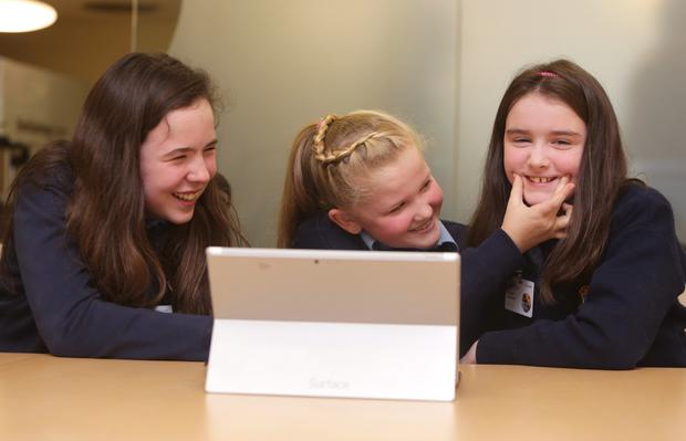 Ella Moore, Emma O'Brien and Rachel Groarke, 6th class students from St Olafs National School, Sandyford taking part in a Minecraft Hour of Code at Microsofts offices. Picture credit; Damien Eagers