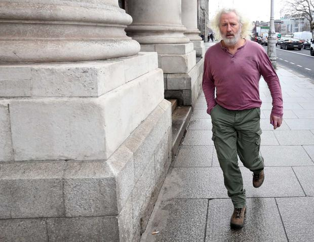 Mick Wallace arrives at the High Court for his bankruptcy hearing. Photo: RollingNews.ie