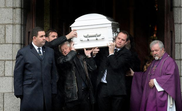 Grief: The coffin being carried from Holy Redeemer Church after the funeral Mass in Bray last Friday for Oisin O'Driscoll (below). Photo: Caroline Quinn