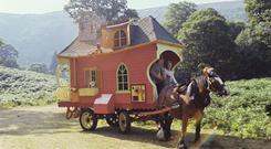 Here comes... Wanderly Wagon — with Eugene Lambert (O'Brien) and Nora O'Mahony (Godmother) in the front seat