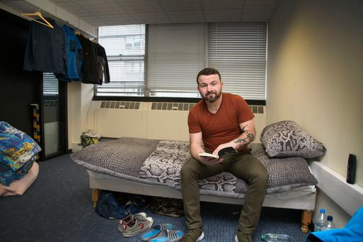 David Collins in his room at Apollo House Picture: Colin O'Riordan
