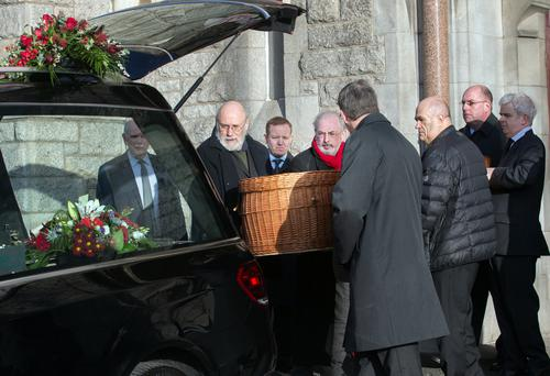 Mourners carry the coffin at the funeral in Donnybrook Picture: Tony Gavin