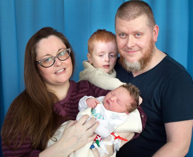 Baby Arlo River Elias with his mother Stacy Kenny, brother Axel and father Elton Rooney Photo: Tony Gavin