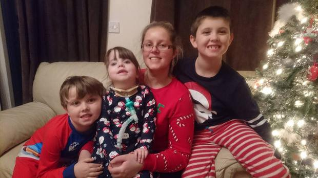 Lisa Flynn with son's Adam (8), Alex (6) and Kate (3)