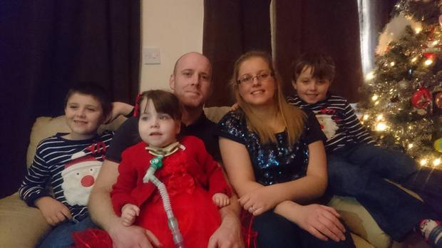 Mark and Lisa Flynn with children Adam, Alex and Kate