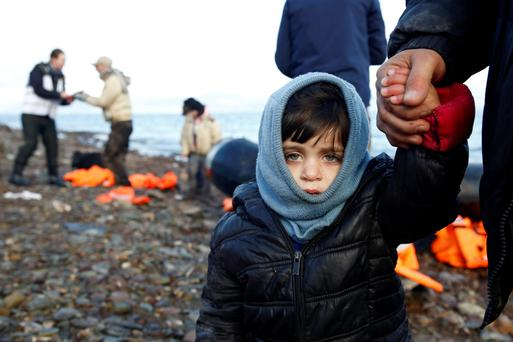 A Syrian child looks on, moments after arriving on a raft with other Syrian refugees on a beach on the Greek island of Lesbos Picture: Reuters